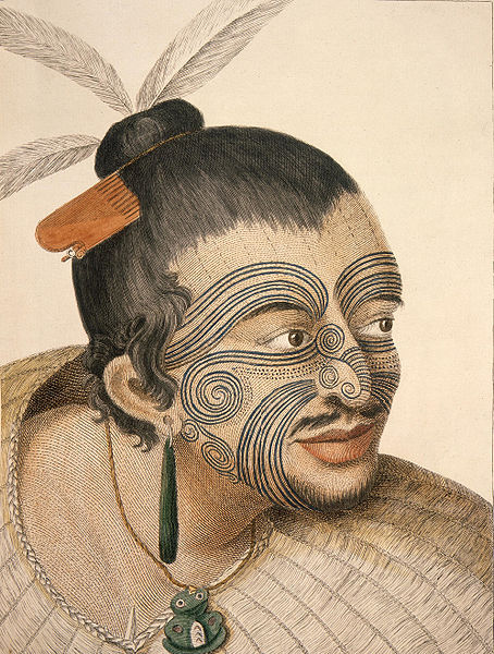 Portrait of a Maori Chief with topknot and feathers, bone comb, facial tatoo, greenstone earring, tiki and woven flax coat. Partly shaved with small beard and moustache. By Sidney Parkinson the artist of on Captain's Cook first expedition. Source Wikipedia Commons.